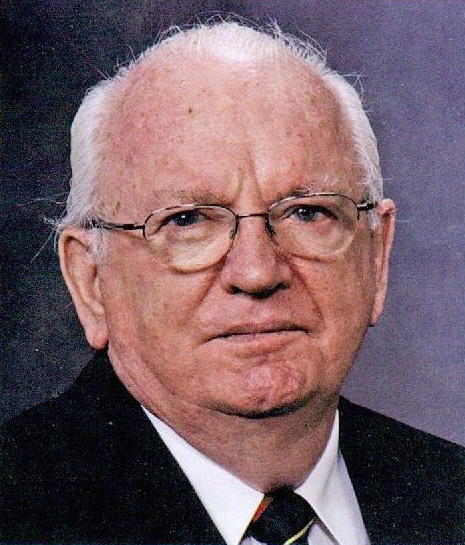 "(Photo reproduced by permission of Rob Ellington.) Charles Ellington, as he appeared in a photo accompanying an article he wrote for The Scrivener, the magazine of the Notaries Public of British Columbia, in the Winter issue of 2006. The article recounted some of the results of ""looking beyond the obvious"" in assisting clients in property conveyancing issues."
